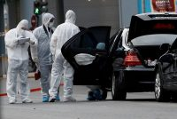 A forensics team inspects the car of former Prime Minister Lucas Papademos of Greece after a parcel bomb exploded in Athens last month. Credit Costas Baltas/Reuters