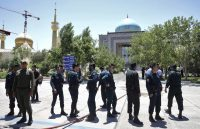 Police control the scene around the shrine of late Iranian revolutionary founder Ayatollah Khomeini, just outside Tehran, after an attack on Wednesday. (Ebrahim Noroozi/AP)