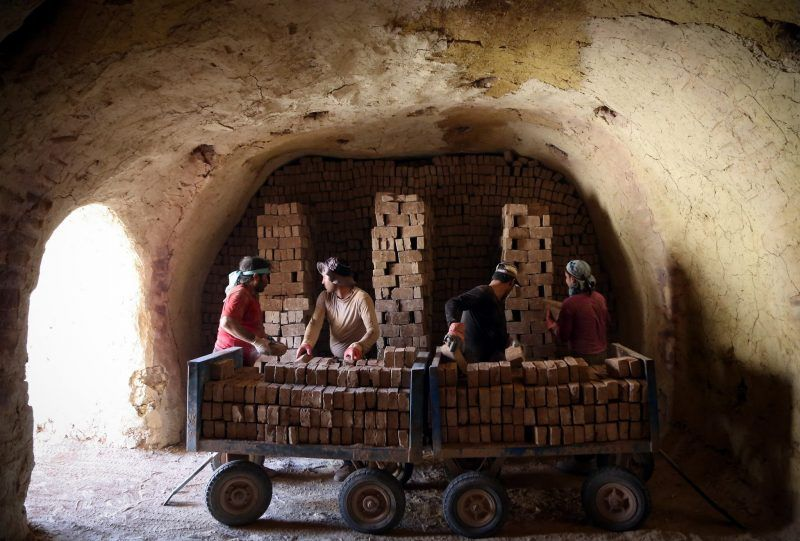 Afghan immigrants working at a brick kiln in Pakdasht, Iran. Millions of undocumented Afghans live in Iran.Fatemeh Bahrami/Anadolu Agency, via Getty Images