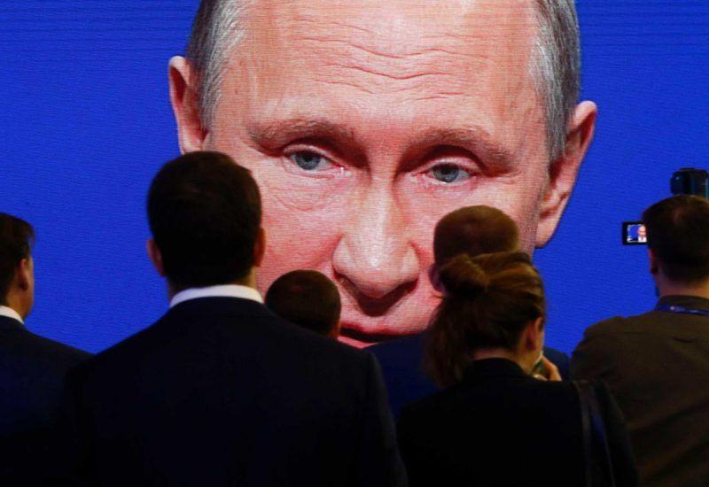Participants of an economic forum in St. Petersburg, Russia, watching Vladimir Putin speak. Credit Sergei Karpukhin/Reuters