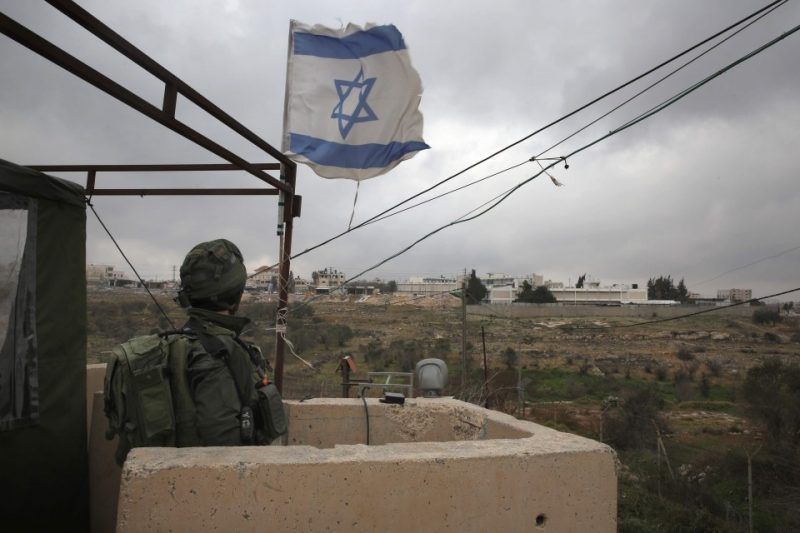 An Israeli soldier stands guard in a monitoring cabin in the Israeli settlement of Beit El near the West Bank city of Ramallah on Jan. 25. (Menahem Kahana/AFP/Getty Images