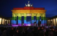 he Brandenburg Gate is seen with a rainbow flag projected onto it during a vigil for victims of a shooting at a gay nightclub in Orlando nearly a week earlier, in front of the U.S. Embassy in Berlin on June 18, 2016. (Adam Berry/Getty Images)