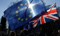 In this file photo, demonstrators fly E.U. and U.K. flags during a rally following an anti-Brexit, pro-European Union march in London on March 25. Tens of thousands of pro-E. U. protesters took to London's streets Saturday to mark the European Union's 60th anniversary. (Daniel Leal-Olivas/Agence France-Presse via Getty Images)