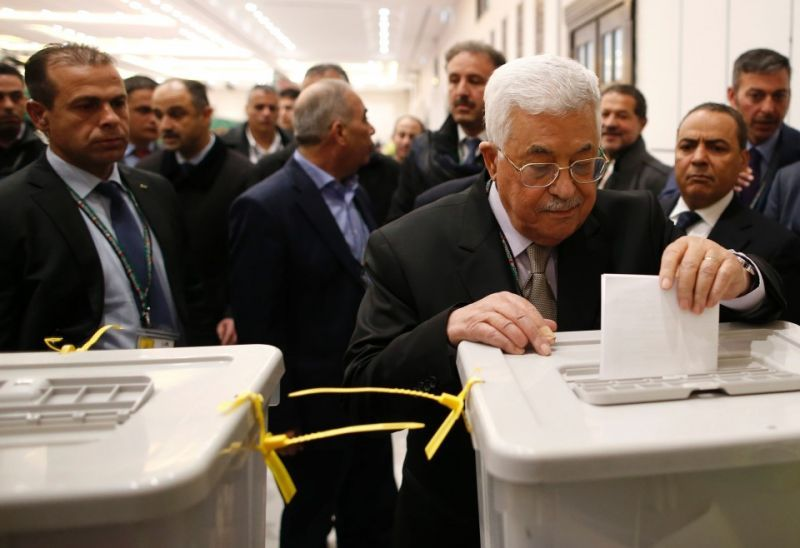 Palestinian Authority President Mahmud Abbas casts his vote at his government's headquarters, in Ramallah in the Israeli occupied West Bank, on Dec. 3. (Ahmad Gharabli/AFP/Getty Images)