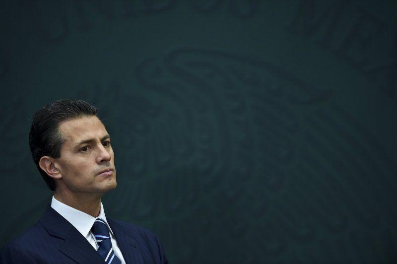 El presidente Enrique Peña Nieto luego del anuncio de la creación de nuevas unidades para prevenir conflictos de interés dentro de la Secretaría de la Función Pública, el 3 de febrero de 2015 YURI CORTEZ/AFP/Getty Images