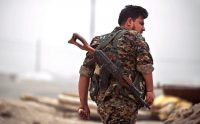 A member of the Kurdish People's Protection Units, known as the Y.P.G., near Raqqa, Syria, last month. Credit Delil Souleiman/Agence France-Presse — Getty Images
