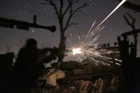 Ukrainian servicemen fighting pro-Russian separatists in Avdiivka, Donetsk region, in March. Credit Anatolii Stepanov/Agence France-Presse — Getty Images