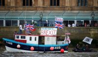 A Brexit flotilla of fishing boats sails up the River Thames into London in June 2016 in a protest against EU fishing quotas. (AFP/Getty Images)