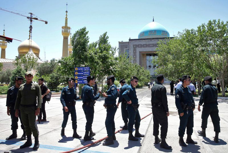 Security personnel outside the mausoleum of Ayatollah Ruhollah Khomeini on Wednesday. Credit Ebrahim Noroozi/Associated Press