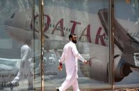 A man walks past the Qatar Airways branch in the Saudi capital, Riyadh, after it had suspended all flights to Saudi Arabia following a severing of relations between major gulf states and Qatar. (Fayez Nureldine/AFP/Getty Images)