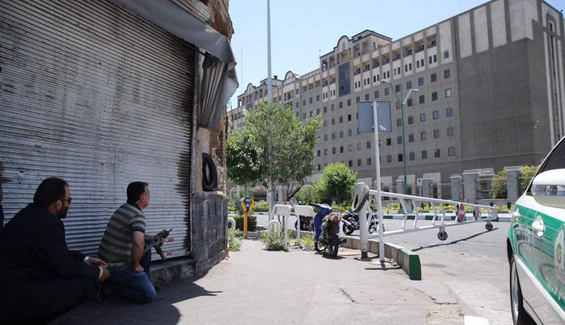 An undercover Iranian policeman outside the Iranian parliament during the 7 June attack on the complex. Photo: Getty Images.