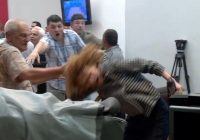 In Macedonia, the Social Democratic Party's vice president, Radmila Sekerinska, has her hair violently pulled as supporters of the country's conservative party invade parliament in Skopje on April 27. The violence followed the election of a new parliamentary speaker. (Radio Free Europe via AP)