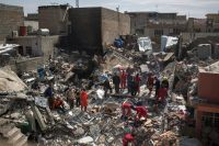 Rescue workers searching through debris for bodies in Mosul, Iraq, in March. Credit Felipe Dana/Associated Press