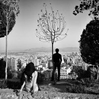 Two people look out over Tehran in 2014. Credit Ako Salemi.