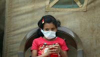 A child suspected of being infected with cholera sits outside a makeshift hospital in Sana'a, Yemen.