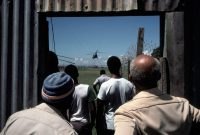 Alex Webb/Magnum Images. Grenadians watching the arrival of US helicopters, St. George, Grenada, 1983