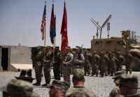 Marines and Afghan National Army personnel during a handover ceremony in the Afghan province of Helmand in April. Credit Wakil Kohsar/Agence France-Press, Getty Images