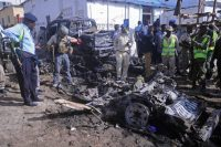 Somali soldiers at the scene of a suicide car-bomb attack on a police station in Mogadishu last month. The explosion killed five people and wounded 10. (Mohamed Abdiwahab/Agence France-Presse via Getty Images)