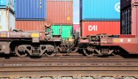 Container cars pulled by Union Pacific locomotives at the Port of Los Angeles. Photo via Getty Images