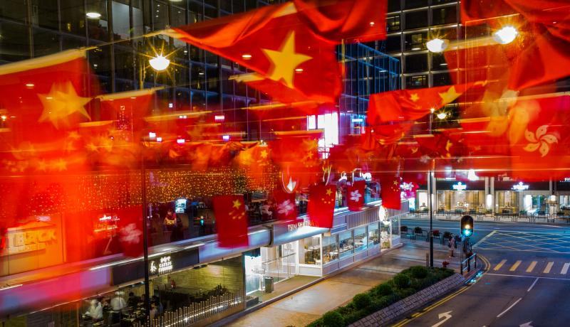 Hong Kong and Chinese flags hang in preparation for President Xi Jinping's visit. Photo: Getty Images.