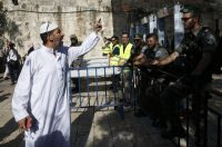 A Palestinian man argues with Israeli border police Sunday near newly installed metal detectors at a main entrance to the al-Aqsa Mosque compound in Jerusalem's Old City after security forces reopened the site. (Ahmad Gharabli/AFP/Getty Images)