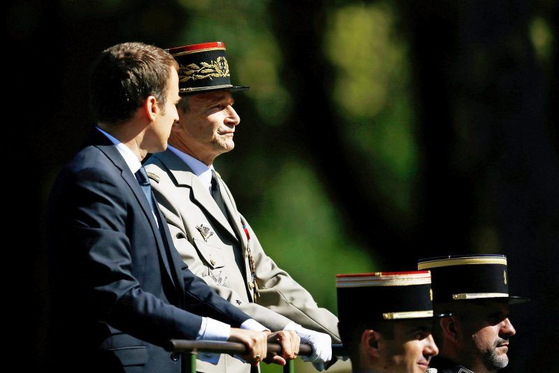 President Emmanuel Macron, left, with General Pierre de Villiers at a Bastille Day parade earlier this month. Credit Stephane Mahe/Reuters