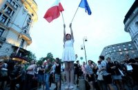 People in Warsaw on July 24 protest proposed laws that would have curtailed the judiciary's independence. (Leszek Szymanski/European Pressphoto Agency)