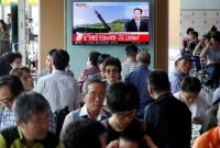 Kim Hong-Ji/Reuters. News of North Korea's ICBM test on a television screen at a railway station, Seoul, July 4, 2017