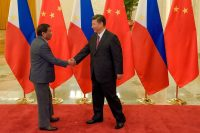 President Xi Jinping of China, right, with President Rodrigo Duterte of the Philippines at a meeting in May in Beijing. Credit Pool photo by Etienne Oliveau