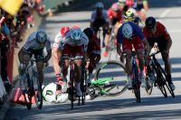 Mark Cavendish on the ground after colliding with Peter Sagan, left, in the Tour de France. Credit Christophe Ena/Associated Press