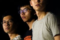"""Leaders of the """"Umbrella Movement"""" Nathan Law, left, Joshua Wong, center, and Alex Chow at a rally in Hong Kong on Wednesday. Credit Tyrone Siu/Reuters"""