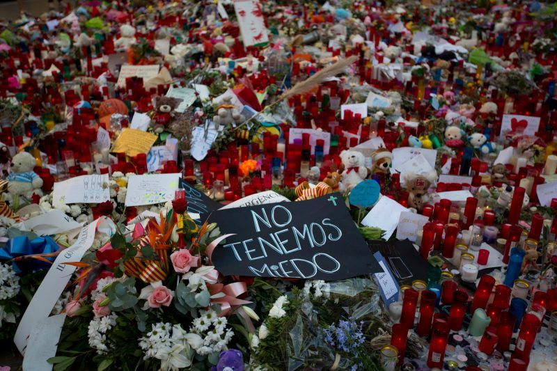 """A banner that says """"We are not afraid"""" lies among a memorial to victims of the Aug. 17 attack on Barcelona's Las Ramblas promenade. Emilio Morenatti/Associated Press"""