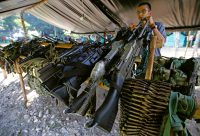 Weapons handed over by the rebels of the Revolutionary Armed Forces of Colombia, or FARC. Credit Fernando Vergara/Associated Press