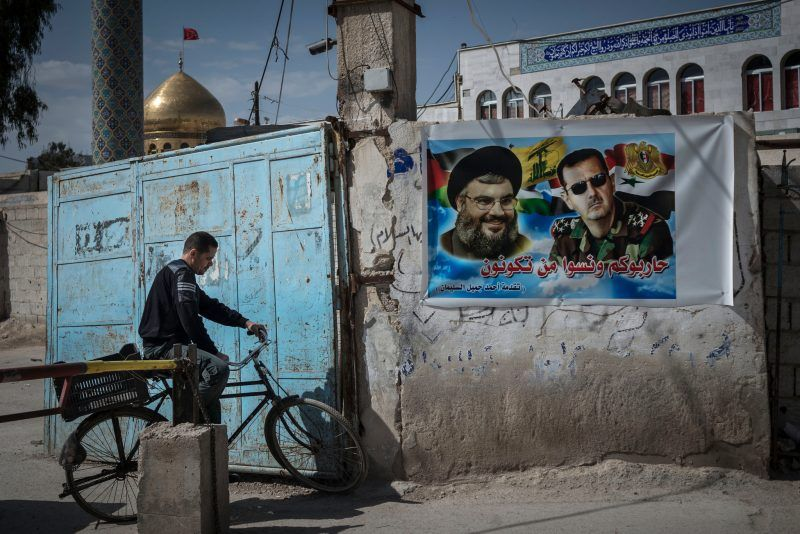 An election poster outside Damascus, Syria, in 2014 of President Bashar al-Assad, right, with Hassan Nasrallah, the Hezbollah leader. Since 2011, the government of Mr. Assad has relied on Iran and its proxies, such as the Lebanese Hezbollah, to stay in power. Credit Sergey Ponomarev for The New York Times