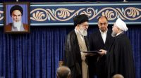 President Hassan Rouhani of Iran receives the presidential mandate from Iran's supreme leader, Ayatollah Ali Khamenei, during an endorsement ceremony in Tehran on Thursday. Reuters