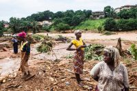 Residents assess the damage after heavy rains triggered flooding and a major mudslide in Freetown, Sierra Leone, last week. Jane Hahn for The New York Times