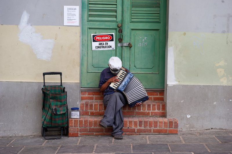 A street performer plays the accordion for money in Old San Juan, Puerto Rico. Credit Alfredo Sosa/The Christian Science Monitor, via Getty Images
