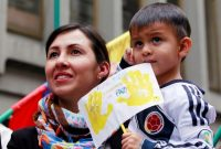 A woman and her son celebrate the signing of a historic ceasefire deal between the Colombian government and the Revolutionary Armed Forces of Colombia in Bogota, Colombia, in June 2016. (Reuters)