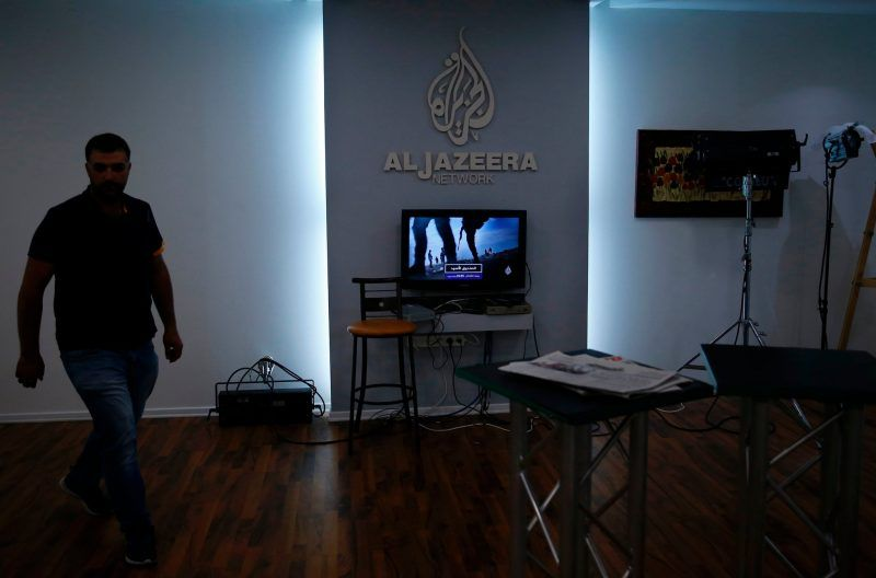 Employees of Al Jazeera are seen at their Jerusalem office in July. Credit Ahmad Gharabli/Agence France-Presse — Getty Images