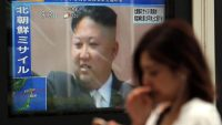A TV screen on a street in Tokyo broadcasts news of North Korea's ballistic missile launch in Chiyoda Ward, Tokyo, on 29 August 2017. AFP/Kota Kawasaki