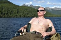 President Vladimir Putin of Russia sunbathing during his vacation last week in the remote Tuva region in southern Siberia. Credit Alexey Nikolsky/Agence France-Presse — Getty Images