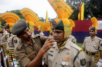 An Indian paramilitary officer adjusts the head gear of a colleague during the final dress rehearsal Sunday ahead of Independence Day celebrations in Agartala, the capital of northeastern state of Tripura. (AFP/Getty Images)
