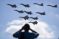 A man watches Russian military jets performing in Alabino, Russia, outside Moscow. (Pavel Golovkin, File/AP Photo)