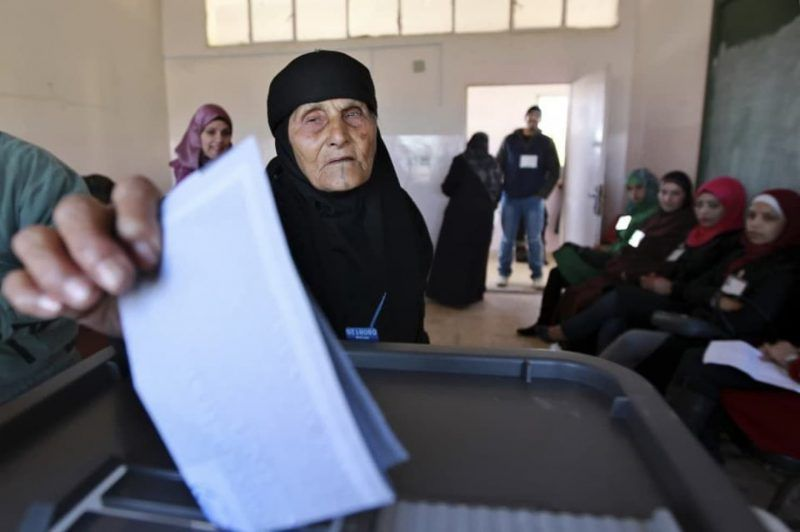 A woman casts her ballot at a polling station in Amman, Jordan, in 2013. (Muhammad Hammad/Reuters)