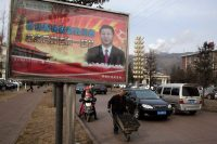 """Ng Han Guan/AP Images. A billboard showing Chinese President Xi Jinping with the slogan, """"To exactly solve the problem of corruption, we must hit both flies and tigers,"""" Gujiao, China, February 2015"""