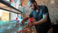 Preparing food at the Ibad al-Rahman's Damascene Delicacies in Idlib, Syria. Photo by Omar Haj Kadour/AFP/Getty Images