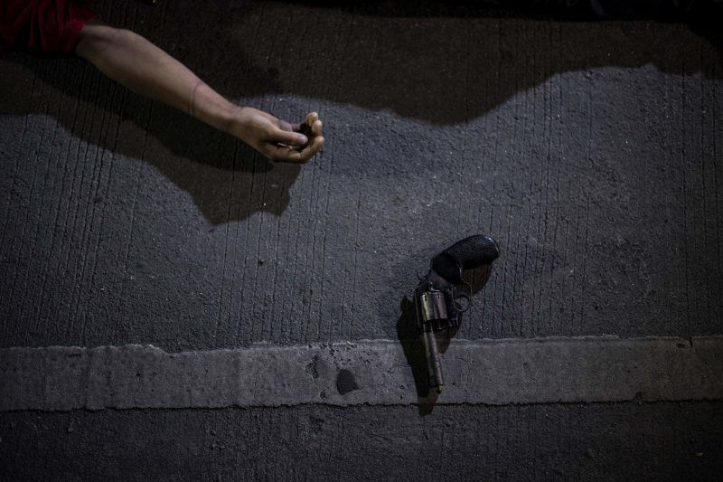 The body of an alleged drug dealer killed during a police operation in Manila, in August. Noel Celis/Agence France-Presse — Getty Images