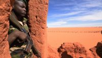 A soldier stands guard in Madama near Niger's border with Libya. Photo: Getty Images.