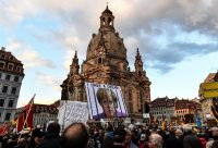 Supporters of right-wing party Alternative for Germany rally against Chancellor Angela Merkel in Dresden, on Monday. Filip Singer/European Pressphoto Agency