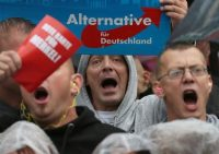 Supporters of the hard-right Alternative for Germany (AfD) party shout slogans during a September campaign rally for German Chancellor Angela Merkel in Torgau, Germany. (Reuters)